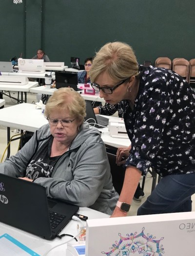 Teacher and student working in Silhouette Studio software during holiday workshop.