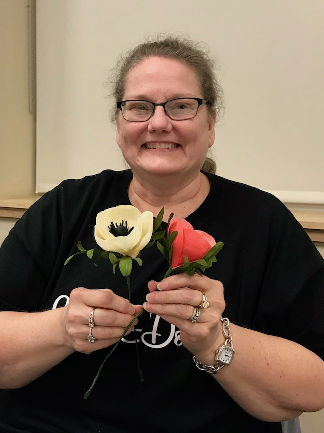 Woman with Crepe Paper Flower