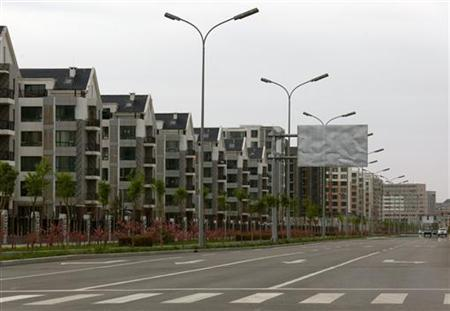 Residential homes line a deserted street in the Kangbashi district of the town of Ordos in China's Inner Mongolia Autonomous Region