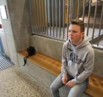 """Brandon Covert, Freshman, sits in the new Bio-Science building, Thursday, February 23, 2017. Brandon states that he has """"met more people in college that I share more interests with than in high school""""."""