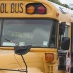 Child in near-miss after car tries to pass school bus