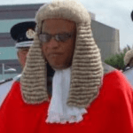CJ calls for challenge to lax US gun laws