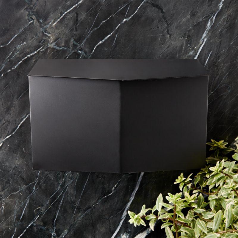 bow angled black wall
