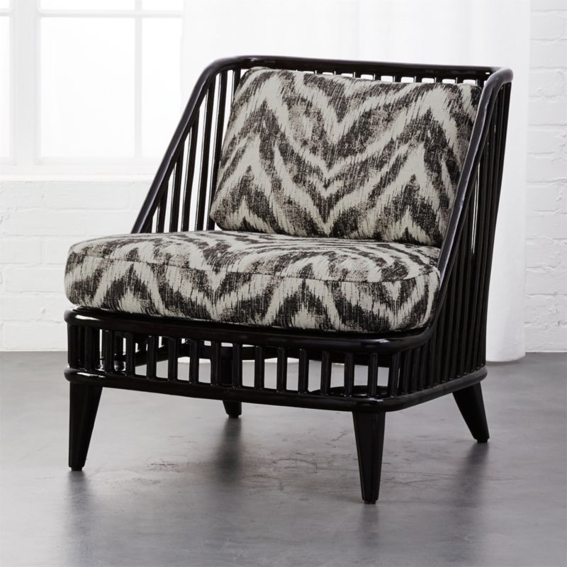 rattan living room chair images of rooms cb2 kaya black with zebra print cushions