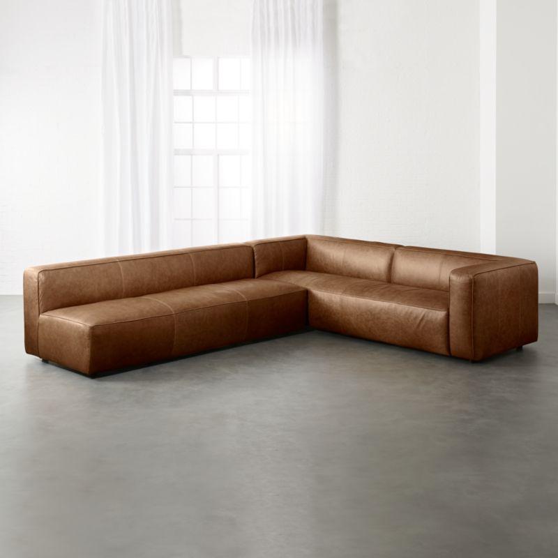 armless sofas duncan phyfe sofa frame modern cb2 lenyx cognac 2 piece leather sectional