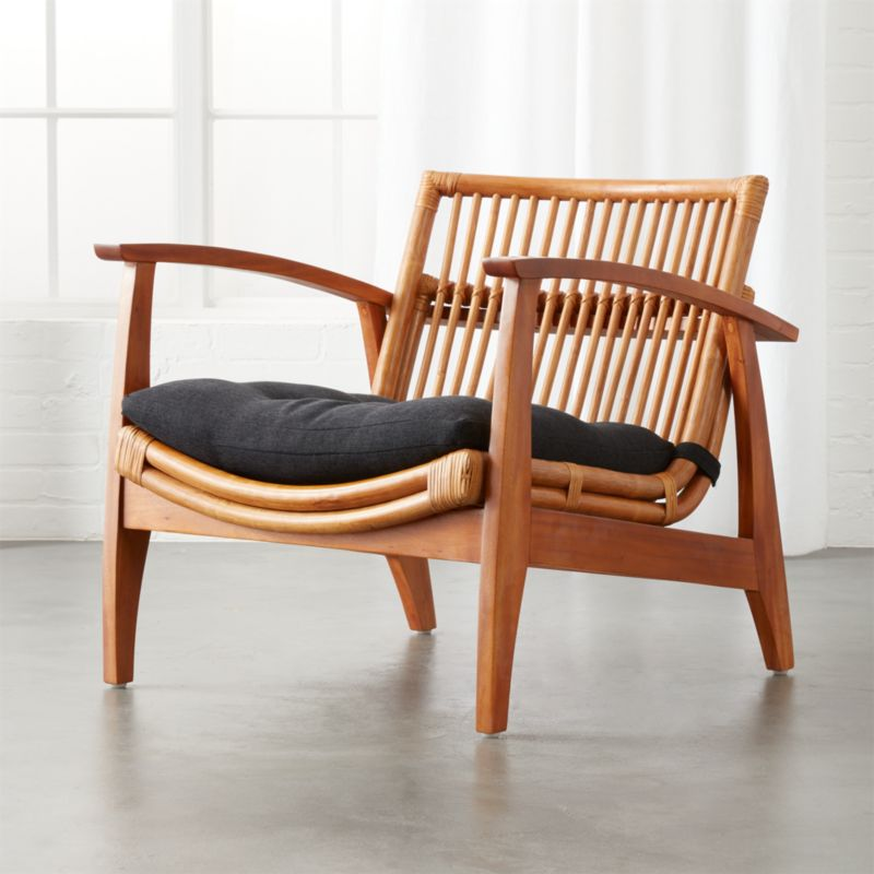 It's likely you and your guests will spend countless hours in this room, discussing and entertaining. Rattan Living Room Chair   CB2