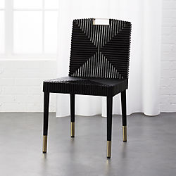 black and white cowhide chair blue swivel uk modern dining chairs accent cafe kitchen cb2 rattan brass