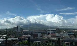 Cloud shrouded Mt. Mayon as viewed from the Food Court of SM City Legazpi. Who needs a new convention center only to view the almost perfect coned volcano?
