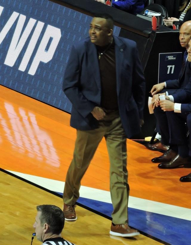 Tulane Green Wave men's basketball coach