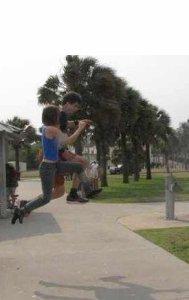 Tracuers Jennifer and Taliesen McCall take a simultaneous leap.