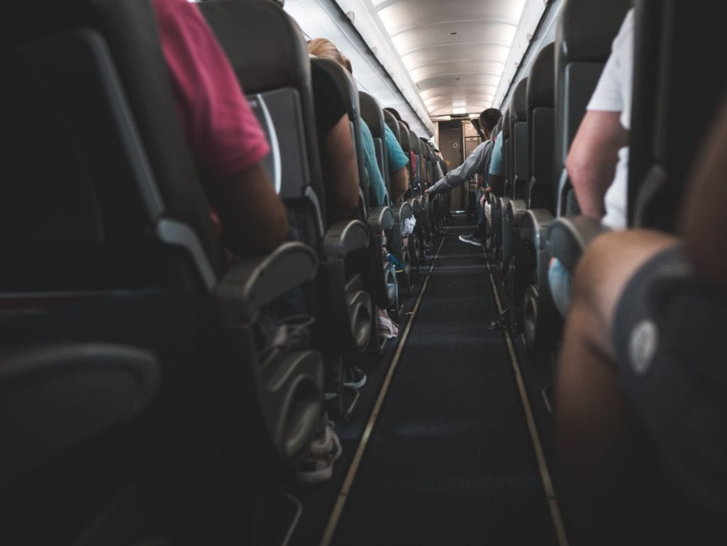 people sitting on plane chairs