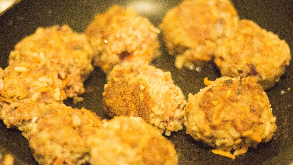 Turn all meatballs over and continue frying