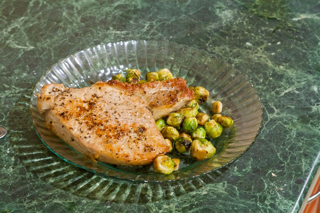 Serving the pork chops with Brussels sprouts