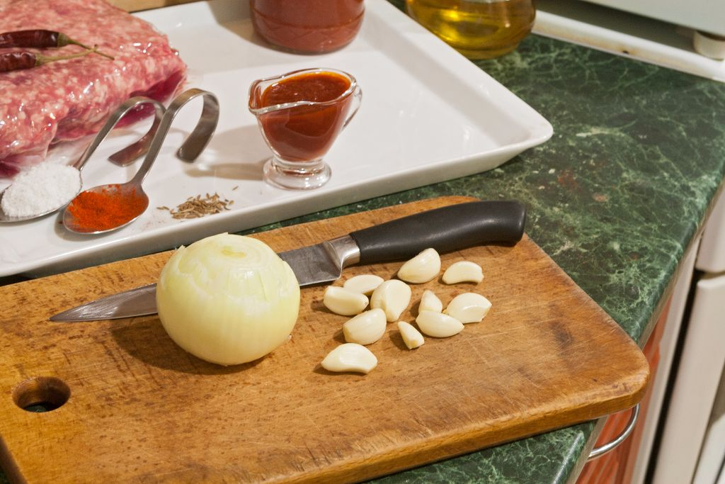 Peeling garlic cloves and onions