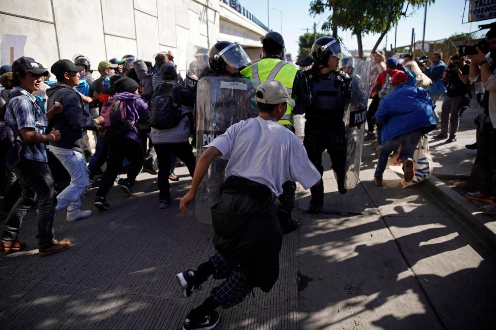 medium resolution of u s agents use tear gas as some migrants try to breach u s mexico border