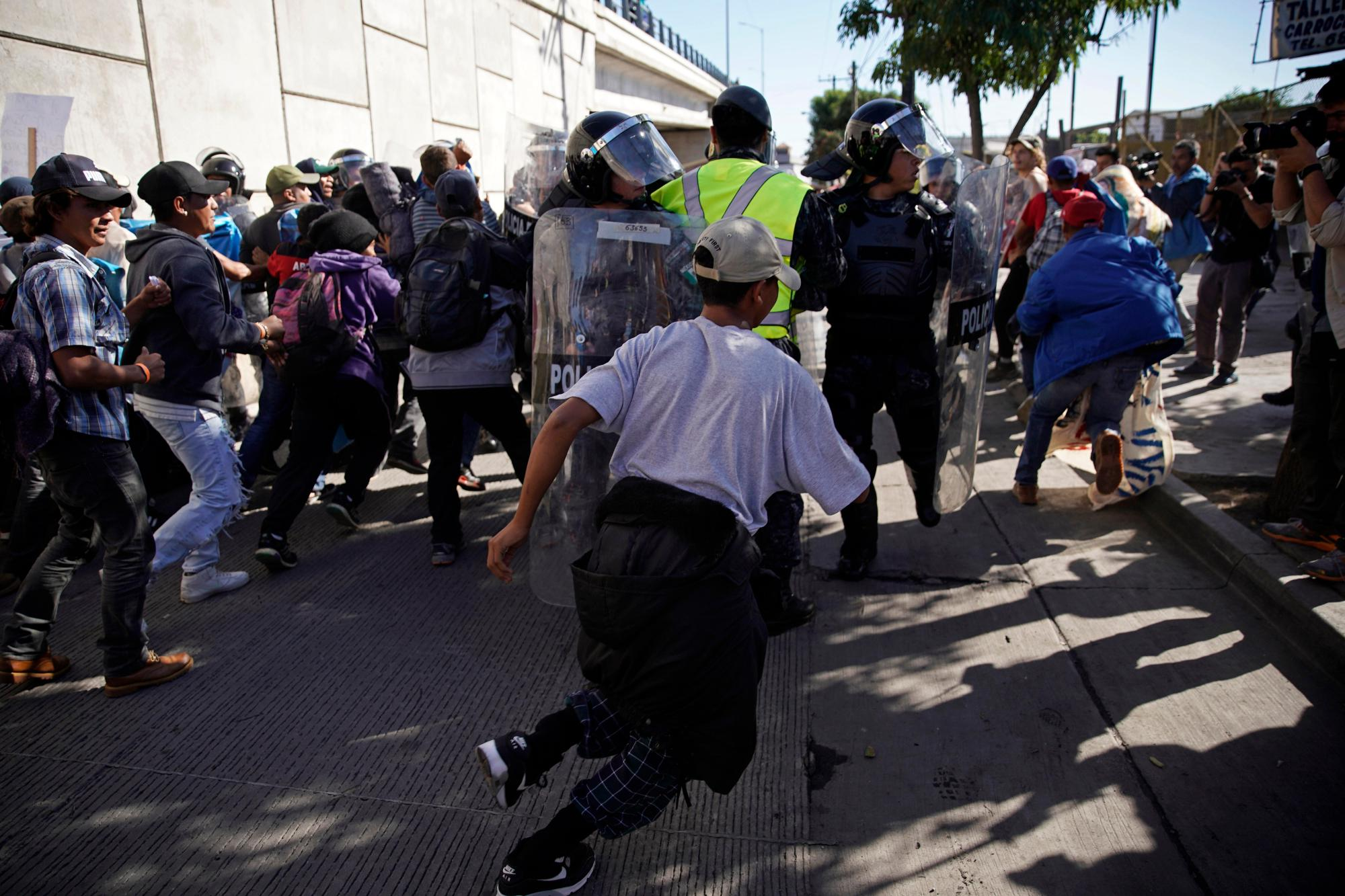 hight resolution of u s agents use tear gas as some migrants try to breach u s mexico border