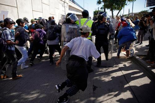 small resolution of u s agents use tear gas as some migrants try to breach u s mexico border