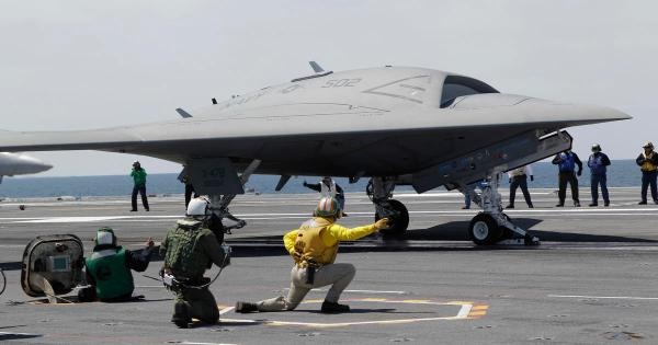 Navy completes first unmanned landing on aircraft carrier