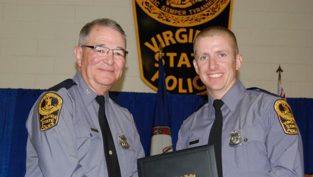 vsp-tpr-dermyer-receiving-his-graduation-diploma-from-vsp-col-w-steven-flaherty-nov-2014.jpg