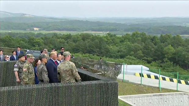 U.S. President Donald Trump and South Korean President Moon Jae-in are seen at the demilitarized zone (DMZ) separating the two Koreas, in Paju