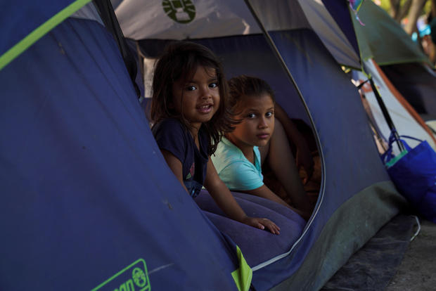 Asylum-seeking children pass their time in an encampment where they live in Matamoros