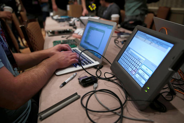 A hacker tries to access and alter data from an electronic poll book in a Voting Machine Hacking Village during the Defcon hacker convention in Las Vegas, Nevada, U.S. on July 29, 2017.  REUTERS