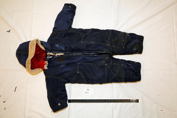 Police handout photo shows belongings of an 18-month old migrant boy Artin Irannezhad