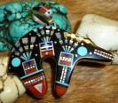 Incredible fine inlay work in this handsome Zuni bear pendant: museum quality!