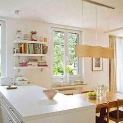 Kitchen Island Designs With Seating Types Of Flooring 内外兼修小厨房如何塞下小餐厅 阿里头条 宽敞操作台的垂直位置 是宽敞原木餐桌的摆放地 餐桌的一端正好的内嵌在橱柜内侧 隐藏了一个座位的长度 这样一来 随时可以进行四人位与六人位的切换