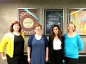 Pictured left to right: Leslie Niemczura Jankowski, Christine Mannix, Shiva Shakeri, Jamie Reinhart; posters from CCAD graduates DANGERDUST hang in the background.
