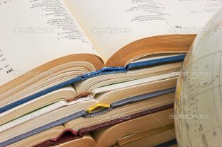 stack of open books and Globe