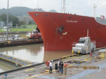 Ship leaving the PanamThe Panama Canal, connecting the Atlantic Ocean with the Pacific Ocean. Ship arrivala Canal