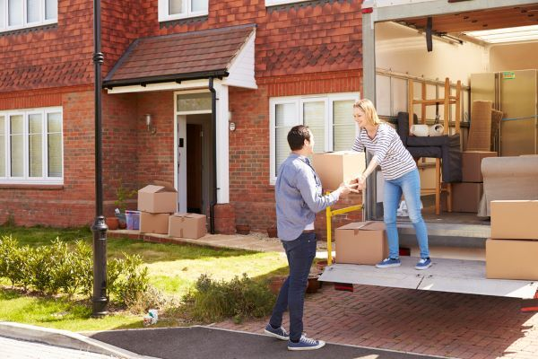couple unloading a removal van