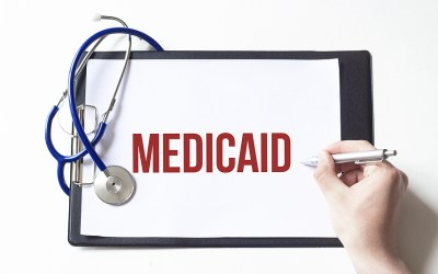 clipboard with word Medicaid