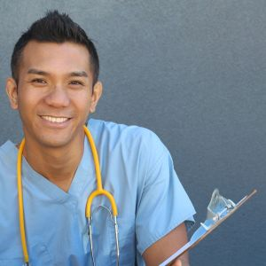 headshot of a healthcare worker who is wearing blue scrubs and a yellow stethoscope