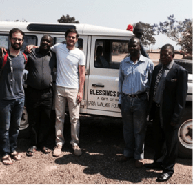 Stanley and Ross with villagers and staff of Blessings Hospital.