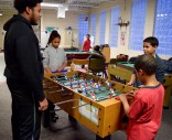 Joseph, at left, a Vincent House youth-turned-mentor, is defeated in a game of foosball by a mentee.
