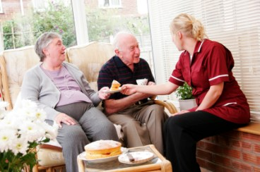 elderly couple and care worker