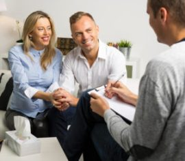 Happy woman and man at couples therapy