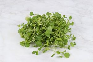Watercress on marble