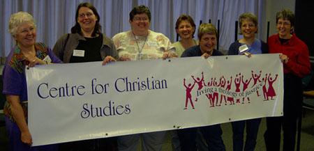 CCS grads holding a banner