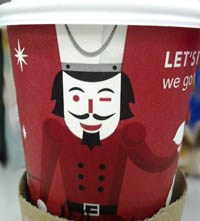 A suspiciously Guy Fawkes-ish Starbucks cup