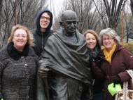 students with statue of Gandhi