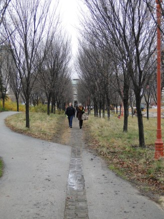 Path to Peace. The straight cobblestone path represents the European tradition, the winding path the Indigenous tradition.
