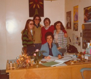 Kay Pearson behind her desk with students