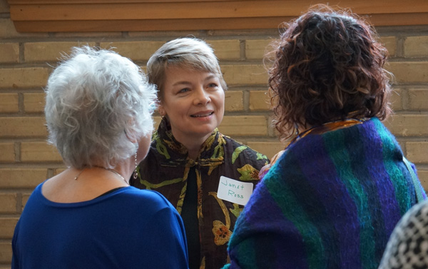 Program Staff Janet Ross in conversation with banquet guests