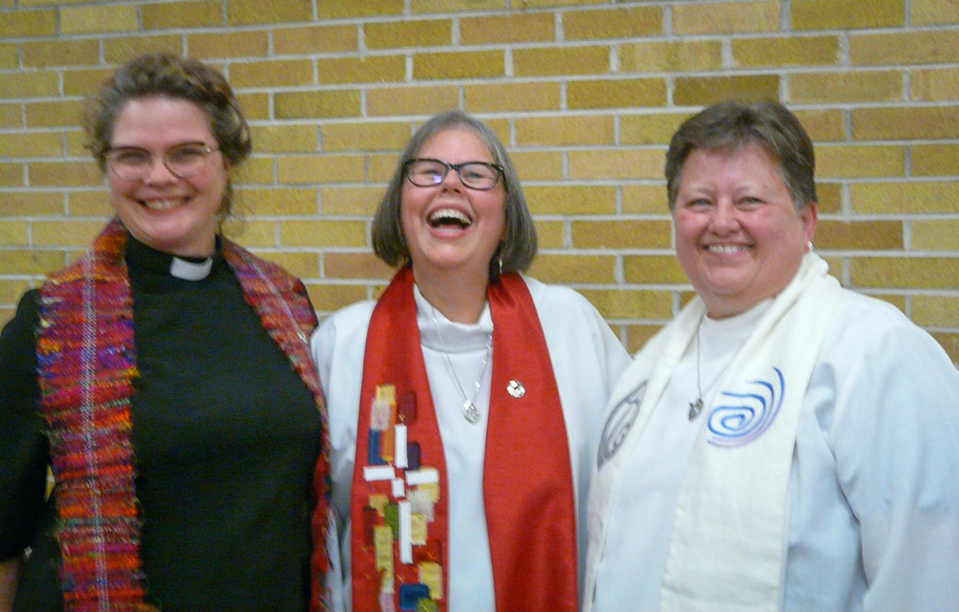 Michelle Owens (L) and Deborah Deavu (R) celebrate with Anita Rowland