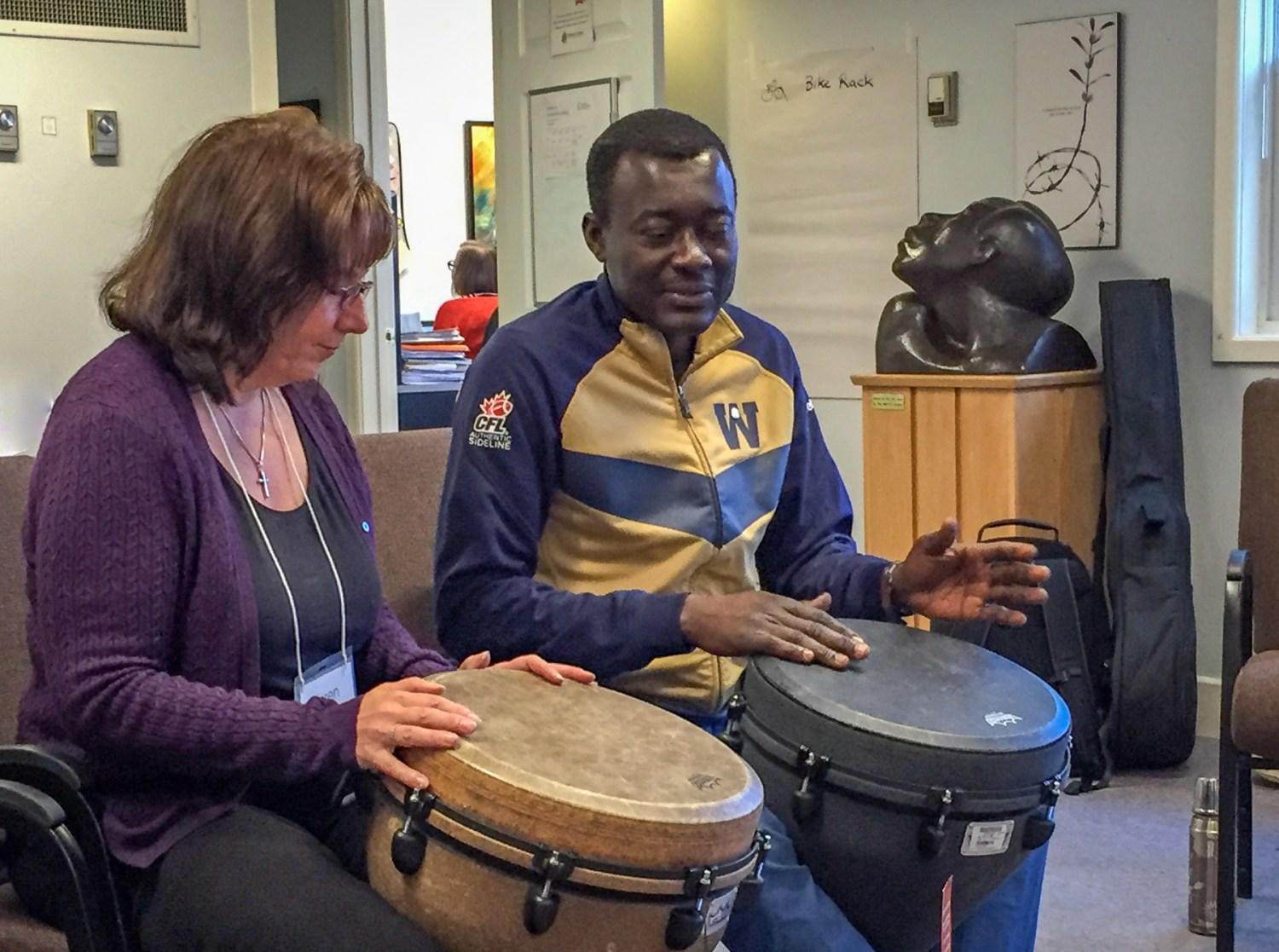 Karen drumming with Raymond.