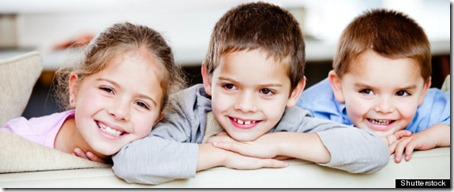 Happy group of children smiling at home; Shutterstock ID 98269124; PO: aol; Job: production; Client: drone