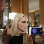 A model gets her makeup done backstage before the Italian designer Donatella Versace Haute Couture Spring/Summer 2014 fashion show for Atelier Versace in Paris